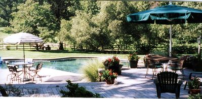 Black bottom pool for extra warmth * hugh deck with lots of seating