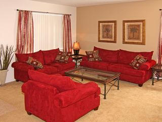 Windwood Bay villa photo - Warm red seating makes the formal living area a cosy place to be!