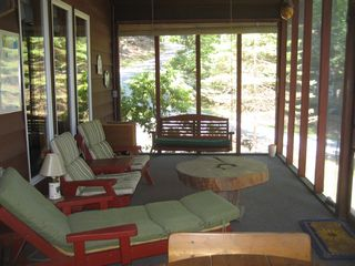 Lake Wallenpaupack house photo - Large screened in porch with door to exit to front yard