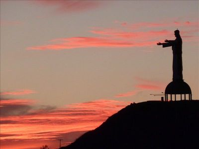 View of sunset and 70' high monument statue of Jesus from rear balcony