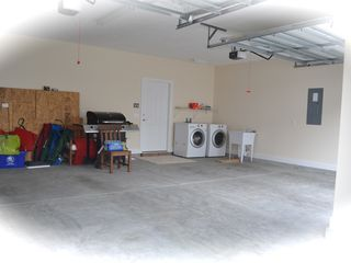 Private Homes house photo - Over sized 2 car garage w/ new LG washer & dryers, a sink wash your seashells