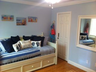 smaller/kids bedroom with twin over twin trundle bed - Indian Shores condo vacation rental photo