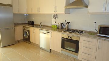 Luxury fitted kitchen with white goods