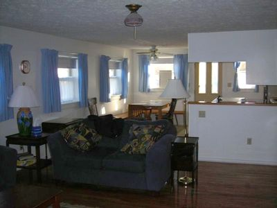 Generous Size Living/Dining Area with TV and View of the Water