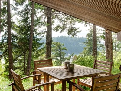 Teak table on covered deck overlooking Chuckanut Bay.