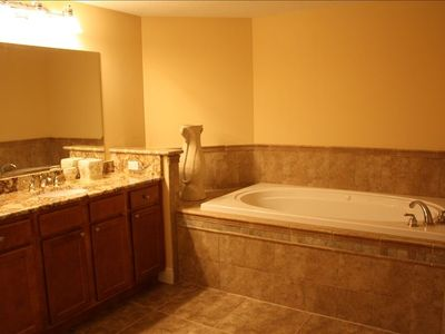 Huge Master  Bathroom ..has double sinks,jacuzzi,separate shower,granite counter