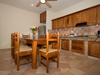Fully equiped kitchen with large dining table which can seat up to eight people.
