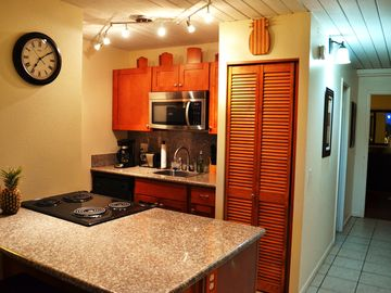 Kihei condo rental - Modern kitchen with granite top. Washer/dryer in the closet. Fridge not shown.