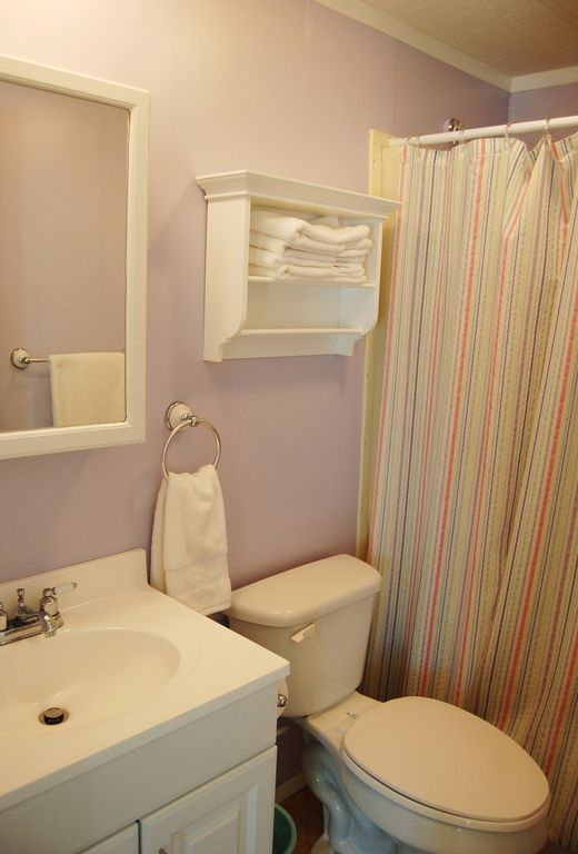 Hall bath with tub/shower combination.