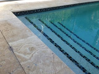 Old Naples house photo - New pool with glass tile and travetine marble patio
