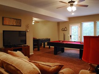 Branson house photo - Lower level family room with pool table, foosball, and 50 inch TV with DVD.