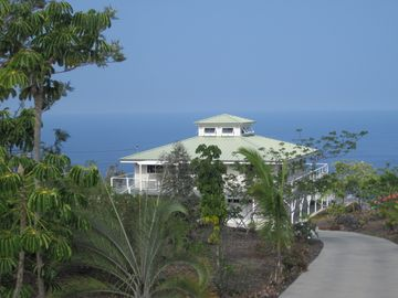 Milolii estate rental - Entrance to The Pineapple Palace. Street side of home, ocean in background.