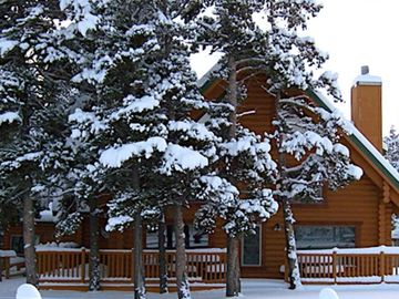 The warm log home in winter