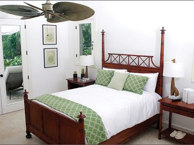 Third bedroom with queen bed and adjacent terrace