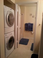Venetian Bay townhome photo - Front Load High Energy Washer and Dryer, adjacent vanity and upstairs bathroom.