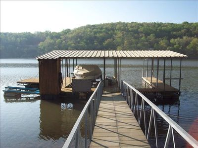 Dock w/ cover & sun  deck, 1 slip for your use. Caught 5 catfish april 1..
