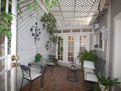 Private, covered patio adjacent to Guest Cottage.