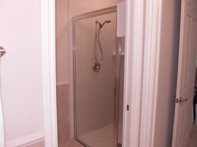 Master B/R features stand up shower with no step