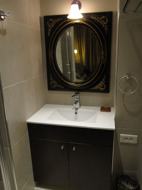 Bathroom with Napoleon III mirror. Towel warmer