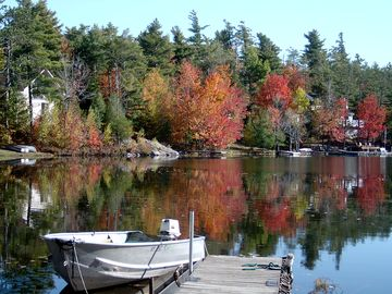 Back dock and fishing boat in Fall.