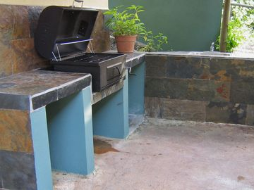 Closer look at BBQ area with water sink.