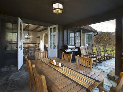Spacious back porch w/ mountain view, locally crafted rockers and outdoor dining