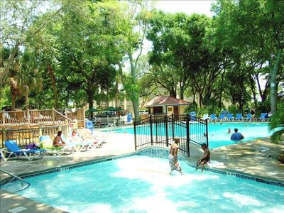 Large solar heated pool with separate swimming area for small children.
