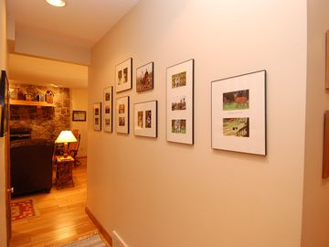 Wall gallery with reminders of fun times at Dancing Bear Lodge