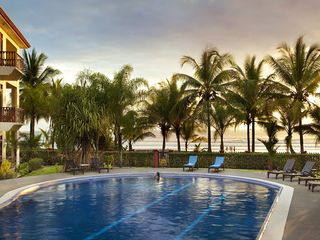 Jaco condo photo - Pool and sunset at Bahia Azul