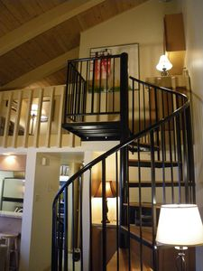 Spiral staircase up to loft and second bedroom/bath