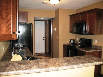 view of kitchen, whirlpool appliances, coffeemaker, toaster, and blender