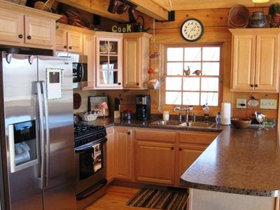 Cook's Kitchen with Gas Stove and new stainless steel appliances