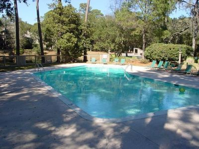 Lovely shaded swimming pool located in complex