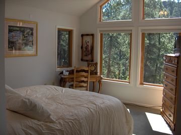 Master bedroom with views from catheral windows
