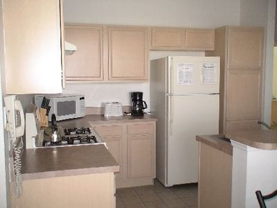 Kitchen has all appliances, breakfast bar. ( we have inside laundry - under A/C)