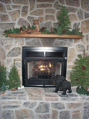 Gas fireplace in great room - Pigeon Forge cabin vacation rental photo