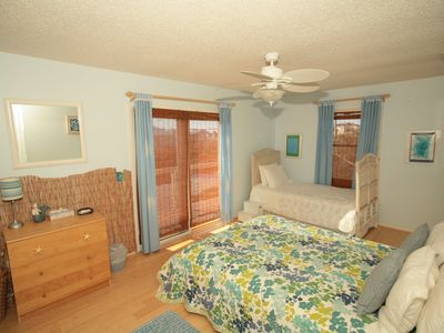 The Upstairs Bedroom Sleeps up to 3 with a Balcony Sunset View of Guana Reserve