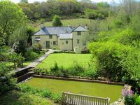 Gooseham Mill House - magical house sleeping 7 with childrens bothy in garden