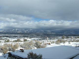 Taos house photo - View of Arroyo Hondo Valley from the Kitchen Window on a Winter Morning.