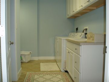 Laundry room with plenty of storage & full-size washer/dryer