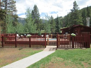 Copper Mountain condo photo - Beautiful deck, hot tub, sauna and share gas grill to enjoy