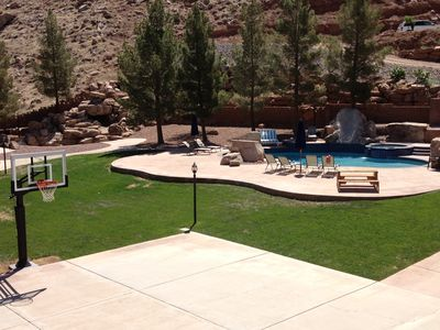 Backyard with basketball court, Heated Pool, Hot Tub.