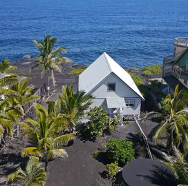 Hilo house rental - Ocean views from most of the house. Waves splash right in your backyard.