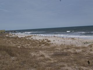 Carolina Beach condo photo - north view and Tiki Bar, yes you can walk