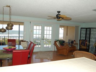 Cocoa Beach condo rental - Kitchen to Living area facing direct ocean, large balcony off of french doors
