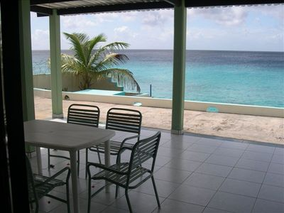 View from the patio overlooking the Caribbean sea from private ocean front villa