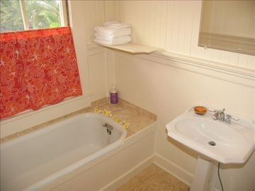 Upstairs bathroom with tub.
