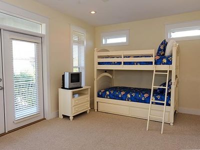This ideal room for kids has a bunk bed  with trundle bed and queen bed.