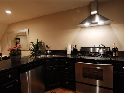 Fully outfitted kitchen with s/s appliances.