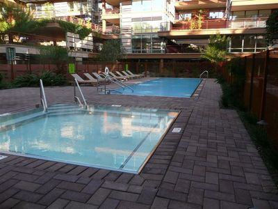 1 of 2 Outdoor Pools and Spas with plenty of lounge chairs